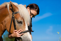 Teenage girl with horse Royalty Free Stock Photography