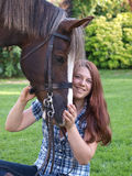 Teenage Girl With Horse. A pretty teenage girl sits with her horse royalty free stock photos