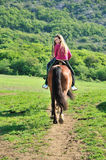 Teenage girl on a horse Stock Images