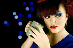 Teenage girl with hot drink in hands stock images
