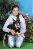 Teenage girl hugging her dog Stock Photography