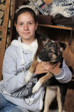 Teenage girl hugging her dog Royalty Free Stock Photo