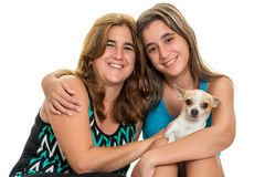 Teenage girl hugging her mother and their little  dog Royalty Free Stock Photos