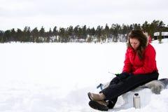 Teenage girl ice fishing stock image
