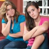 Teenage girl ignoring her worried mother Stock Photos