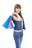 Teenage girl in jeans clothes with shopping bags isolated on whi Royalty Free Stock Image