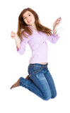 Teenage girl is jumping. Isolated on white background stock photo