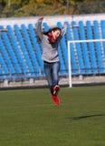 Teenage girl jumping Stock Photos