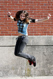 Teenage Girl Jumping in the air Royalty Free Stock Images
