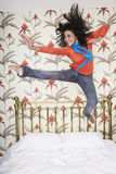 Teenage Girl Jumping On Bed Royalty Free Stock Images