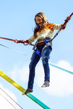 Teenage girl jumping with bungie Stock Photo