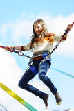 Teenage girl jumping with bungie Royalty Free Stock Photos