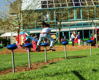 Teenage girl jumping on child playground Stock Photography