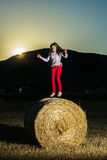 Teenage girl jumping from the haystack Royalty Free Stock Photos