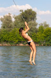 Teenage girl jumping in the river Stock Photography