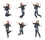 Teenage girl jumping on white background Royalty Free Stock Image