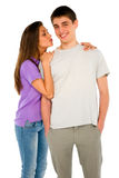 Teenage girl kissing teenage boy Stock Images