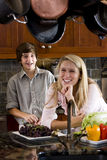 Teenage girl in kitchen with younger brother Royalty Free Stock Photography
