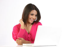 Teenage girl with the laptop. Teenage girl feeling happy with the laptop royalty free stock photos