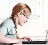 Teenage girl with laptop Stock Photos