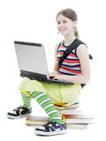 Teenage girl with a laptop Royalty Free Stock Photos