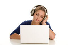 Teenage girl with laptop. And headphones isolated onw hiwte background royalty free stock photography