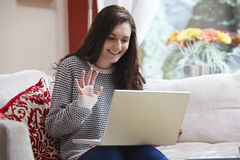 Teenage girl on laptop Stock Photos