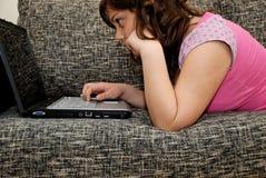 Teenage girl with laptop. Computer Stock Photos