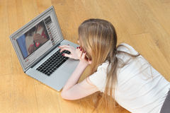 Teenage girl on laptop Stock Photo
