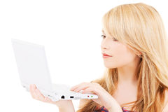 Teenage girl with laptop computer royalty free stock photo