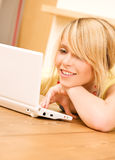 Teenage girl with laptop computer Stock Photos