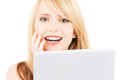 Teenage girl with laptop computer Stock Images
