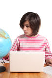 Teenage girl with laptop and globe Royalty Free Stock Photography