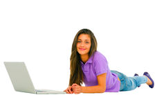Teenage girl with laptop Stock Images