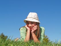Teenage girl laying in grass Royalty Free Stock Photos
