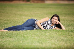 Teenage Girl Laying on Grass Stock Photos