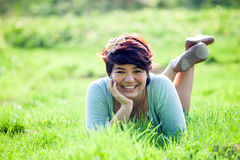 Teenage Girl Laying in Grass Stock Image