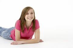 Teenage Girl Laying On Stomach. Looking at camera Royalty Free Stock Photos