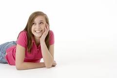 Teenage Girl Laying On Stomach. Looking at camera Royalty Free Stock Image