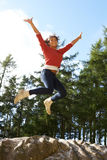 Teenage Girl Leaping In Air Outdoors Stock Photos