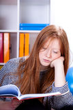 Teenage girl learning. Beautiful teenage girl learning in her room Stock Image