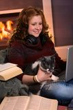 Teenage girl learning at home with cat Royalty Free Stock Photo