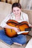 Teenage girl learning playing by guitar Stock Image