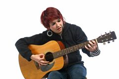 Teenage girl learning to play guitar Royalty Free Stock Photos