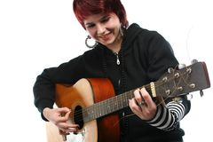 Teenage girl learning to play guitar Royalty Free Stock Image