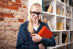 Teenage girl in a library Stock Image