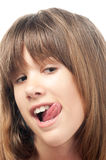 Teenage girl licking her lips Royalty Free Stock Images