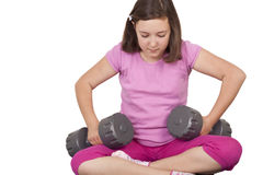 Teenage girl lifting weight Stock Images