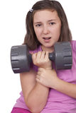 Teenage girl lifting weight Royalty Free Stock Images