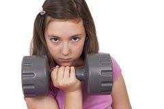 Teenage girl lifting weight Stock Image